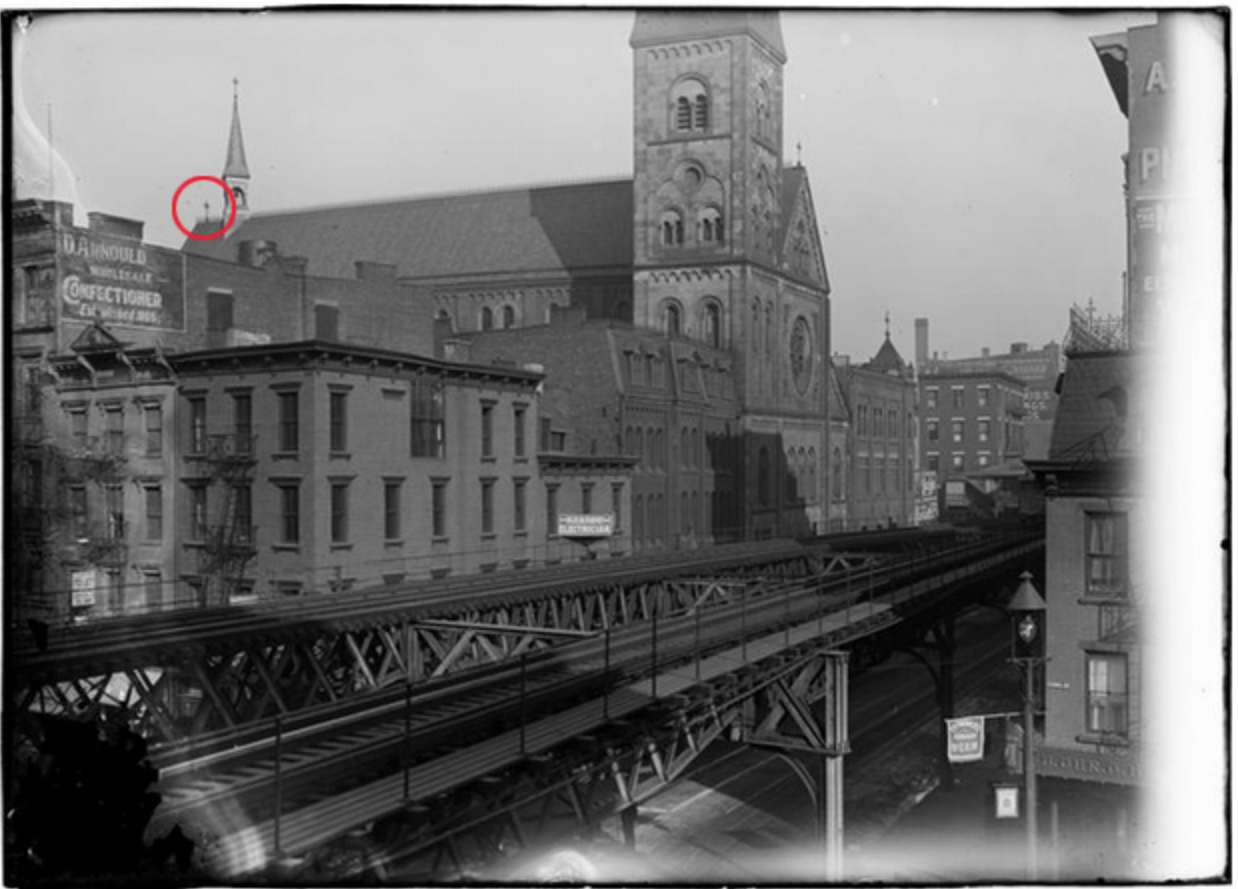 "Rick Parker circles the cross he ""saved"" from the church in a photo taken when the elevated train ran down West Broadway"