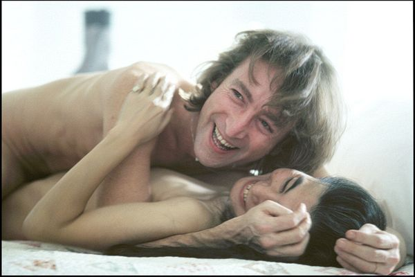 John Lennon and Yoko Ono in Bed Laughing