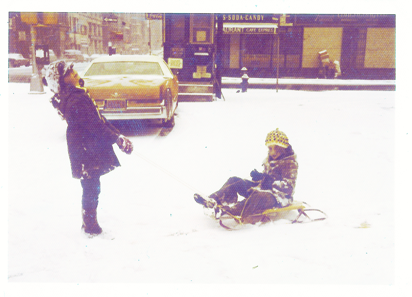 Sledding in the parking lot, ca 1975