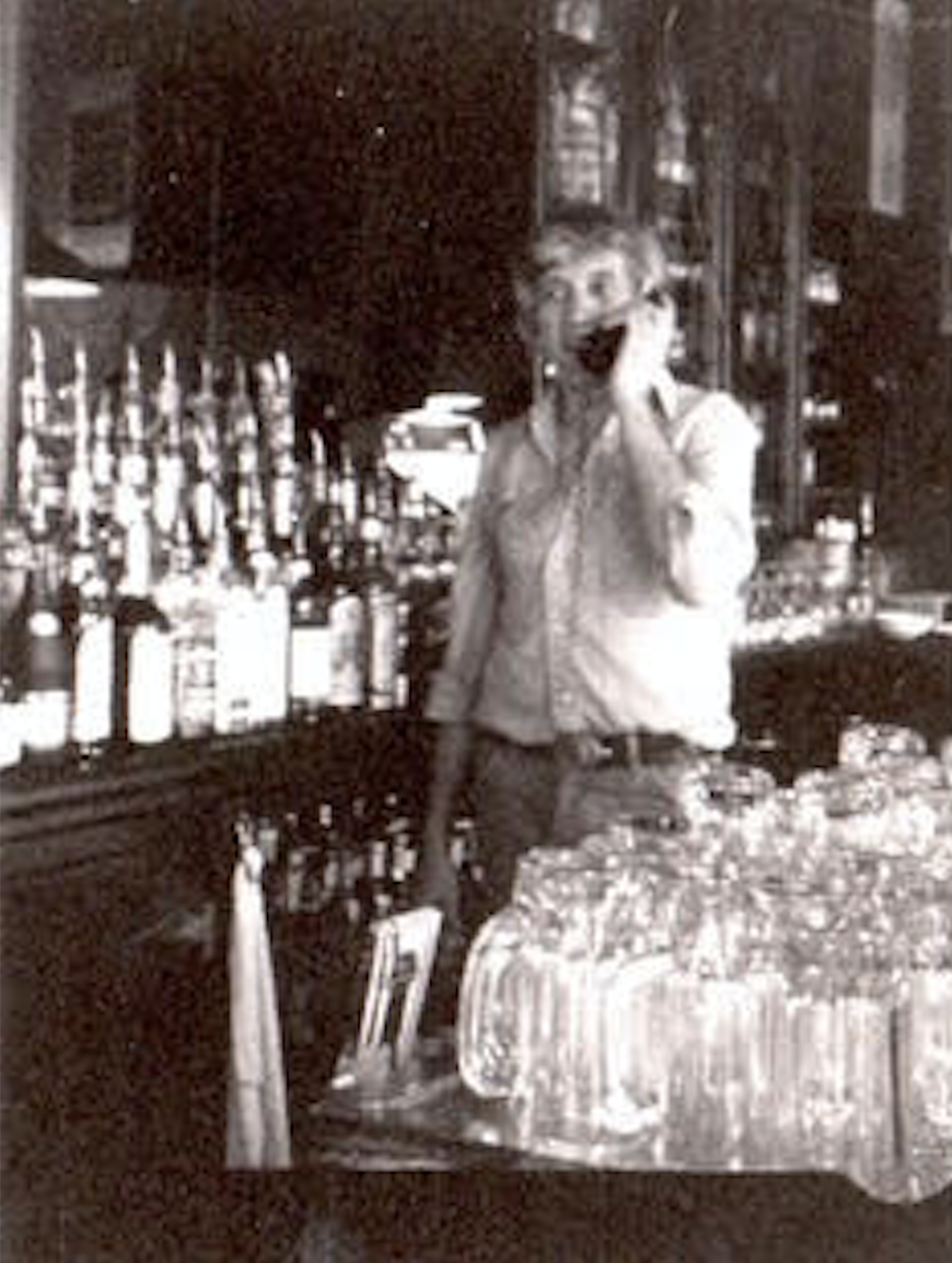 George Kokines, working as a bartender at Fanelli's (looks like; he also tended bar at the Broome Street Bar).  I'd say this was early 80s).