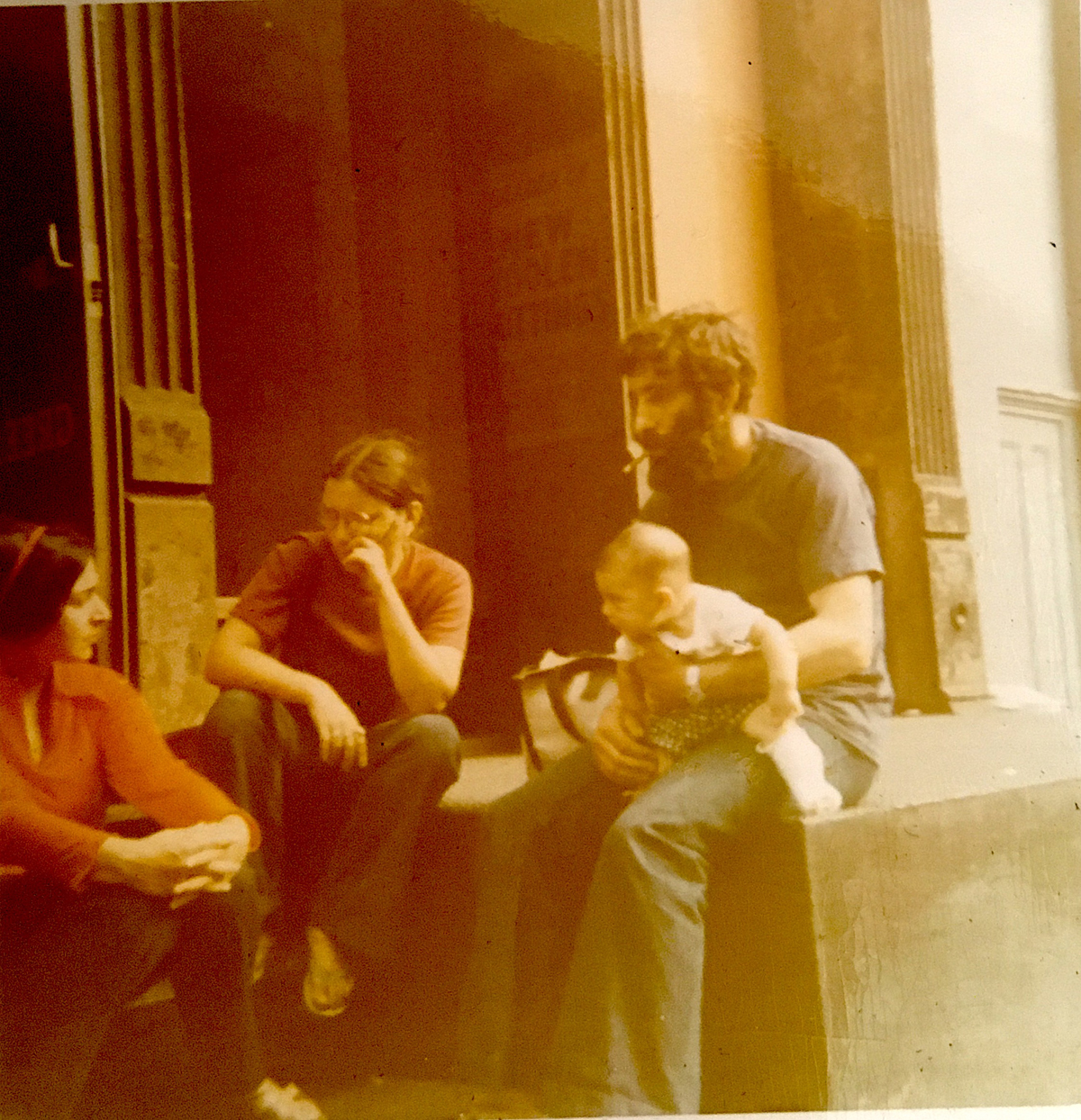 from left to right: my mother, Martha Moses, an unknown friend, my father smoking (as always) holding me outside their loft building, 16 Greene St., 1971.